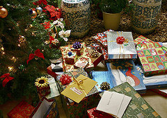 Image of gifts under a Christmas Tree Ornament.
