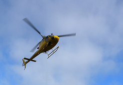 image of a hovering helicopter.