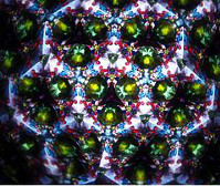 Multiple images of colored glass view through a kaleidoscope.
