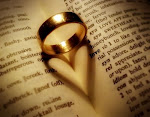 Image of a ring on a book, casting a heart=shaped shadow.